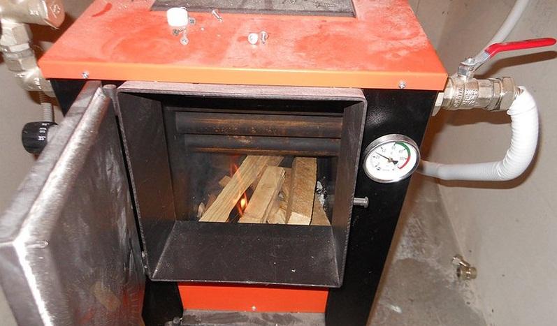 Комбинированные отопительные котлы - дрова электричество 2