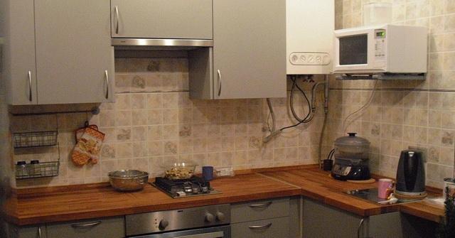 Как спрятать газовый котел на кухне - фото и идеи 7