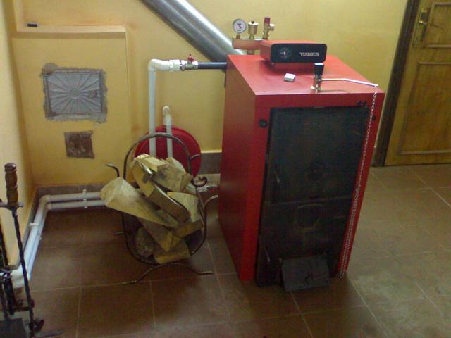 Котлы для отопления частного дома на дровах и электричестве 4